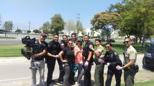 Miss Lindsay was selected to choreograph both winning entries for Chino Valley Medical Center's Pink Glove Dance Video for 2 years straight.  Here she is working with some of Chino & Chino Hills' finest!