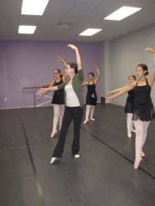 Miss Lindsay teaching a teen ballet class