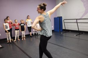 Miss Abby rehearsing the finale with her students.